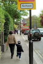 07-05-2004 - A mother walks her five year-old son to his private school in central London © Philip Wolmuth