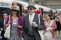 18-06-2009 - Passengers at Waterloo station prepare to board a train to Ascot racecourse. © Philip Wolmuth