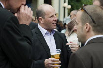 18-06-2009 - Businessmen drinking beer outside a pub in Ascot. © Philip Wolmuth