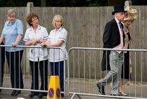 18-06-2009 - Staff from Heatherwood Hospital watch racegoers approach the Royal Enclosure at Ascot racecourse on Ladies Day. © Philip Wolmuth