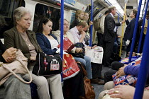08-07-2009 - Passengers on the London underground. © Philip Wolmuth