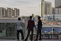 15-09-2011 - Young men look out over the London 2012 Olympic construction site from Westfield Stratford City, the largest urban shopping centre in Europe. © Philip Wolmuth