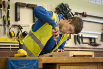 07-11-2011 - A 15 year old school drop-out working in a carpentry workshop while on placement at a college run by Barnsley Community Build, a social enterprise, South Yorkshire. © Philip Wolmuth