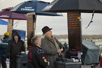 09-12-2011 - On-course bookmaker at Doncaster racecourse checking the odds. © Philip Wolmuth