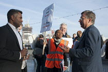17-10-2012 - RMT tube cleaners protest for a Living Wage lobbying Labour Party group members outside the Greater London Assembly. © Philip Wolmuth