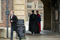 29-05-2013 - Two teachers in gowns at the entrance to Eton College. © Philip Wolmuth