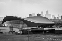 01-04-2014 - Smog caused by air pollutants mixing with dust from the Sahara obscures the view of Canary Wharf beyond the Aquatics Centre designed by architect Zaha Hadid in the Queen Elizabeth Olympic Park, Stratf... © Philip Wolmuth