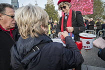 11-11-2014 - Selling poppies on behalf of the Royal British Legion. Crowds mark Armistice Day at the Tower of London 100 years after the start of the First World War. © Philip Wolmuth