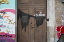 15-03-2015 - Empty house marked by campaigners as number 30 of 75,000 left vacant in Malaga, Spain. © Philip Wolmuth