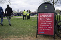 19-04-2015 - Police sign warning that Cannabis is illegal. Anyone found in possession of drugs faces arrest and prosecution. Legalise Cannabis Day, an annual 4/20 event in the campaign to legalise use rather than... © Philip Wolmuth