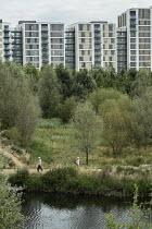 30-07-2015 - Housing and parkland in Stratford, London. East Village, originally the Athletes Village for the 2012 London Olympic Games, has been converted to provide 2818 new homes for private sale and rent by Ge... © Philip Wolmuth