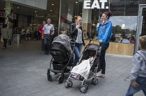 30-07-2015 - Two young mothers smoking cigarettes Stratford London. © Philip Wolmuth