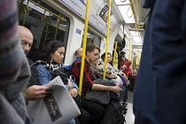 10-05-2015 - Crowded rush hour tube train carriage, London underground © Philip Wolmuth