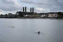06-10-2015 - Canoeists on the river Thames London rowing past Greenwich Power Station © Philip Wolmuth
