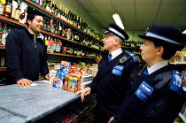 02-05-2003 - PSCO David Wylie & PSCO Carol Phillips chatting to local shopkeeper Serdar Simsik . They are some of the 11 new Police Community Support Officers. © Joanne O'Brien