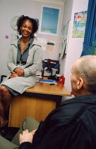 20021024 - Staff member and client at hostel for people with mental health problems © Joanne O'Brien