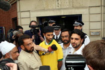 18-06-2006 - Brother (c) of Abdul Kahar Kalam and Abdul Koyair Kalam handing in a letter to Forest Gate police station during a protest against a police raid on the home of brothers in the early hours of 2 June. A... © Joanne O'Brien