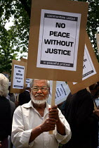 18-06-2006 - Protest against a police raid on the home of brothers Abdul Kahar Kalam and Abdul Koyair Kalam which took place in the early hours of 2. June. Abdul Kahar Kalam was shot by the police and both brother... © Joanne O'Brien