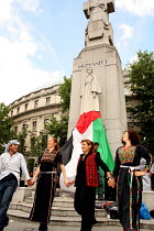 08-07-2006 - DABKE protest, Trafalgar Square London. Dabke is the name of the national Palestinian folklore dance Protesters expressing their frustration with the current deteriorating humanitarian situation in th... © Joanne O'Brien