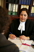 21-12-2006 - Poonam Bhari, barrister specialising in family law taking instructions from client in her chambers, London © Joanne O'Brien