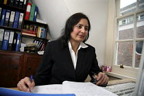 21-12-2006 - Poonam Bhari, barrister specialising in family law, in her chambers in London. © Joanne O'Brien