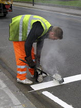 30-03-2008 - Man painting white lines on road for new pedestrian crossing © Joanne O'Brien