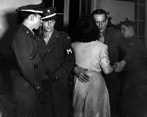 12-03-1949 - American Military Police patrol the Broadway Club in Warrington where off duty US GIs stationed at Burtonwood USAF airbase dance with local women, The airbase was reopened in 1948 to support the Wests... © Elizabeth Chat