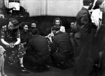 12-03-1949 - Off-duty American GIs from Burtonwood USAF airbase chatting to local women between dances at the Broadway Club in Warrington. The airbase was reopened in 1948 to support the Wests Cold War effort thro... © Elizabeth Chat