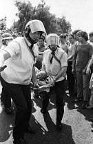 18-06-1984 - Older miner is carried away by ambulance staff, after he was injured on the picket line during violent clashes between miners and riot police officers on the picket lines at the Orgreave coking plant... © John Harris