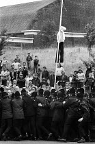 22-08-1984 - Pickets push against police lines Silverwood Colliery 1984 Effergy of a scab hanging from a post. Police escorting strike breakers across NUM picket line during the Miners Strike, Yorkshire. An efferg... © John Harris