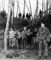 11-12-1983 - Greenham Common. Soldiers stand guard over women who successfully entered the US air base as part of their campaign of direct action for peace and against nuclear weapons held at the site. © Melanie Friend