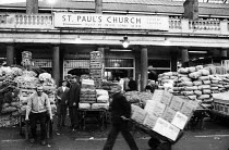 13-12-1971 - Covent Garden fruit and vegetable market, London, 1971. Covent Garden porters at work. © Mike Tull