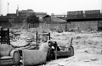 11-07-1962 - Two boys playing outdoors, post war bombsite, 1960s near King's Cross, still a common feature of poorer parts of London © Romano Cagnoni