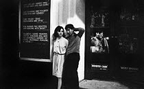 11-07-1964 - Young couple outside West End theatre in London in 1964. © Romano Cagnoni