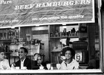 02-05-1962 - Customers in a hamburger bar just off Trafalgar Square in the early 1960's © Romano Cagnoni