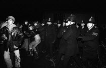 29-11-1983 - Stockport Messenger Police officers grapple with trade union members at a mass picket in support of NGA members on strike in a dispute with Eddie Shahs Messenger Newspaper Group over his use of non-un... © Stefano Cagnoni