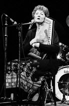 25-11-1984 - Folk singer and activist, Peggy Seeger, performing at the Here We Go benefit gig in support of the miners strike, London, 1984. © Stefano Cagnoni