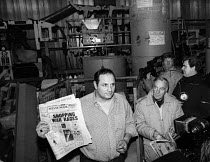 30-11-1983 - Stockport Messenger Eddie Shah holds an edition of The Stockport Messenger, produced by non-union workers, to media in his printing plant at Messenger Newspaper Group, during a dispute with the NGA me... © John Smith