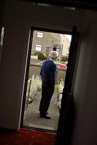 14-07-2007 - A man who suffers from dementia and has a heart condition, at his front door in Caithness. © Rob Bremner