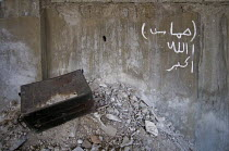 12-06-2008 - Lebanese Army Bullet Case and Hamas graffiti, Nahr al-Bared Palestinian refugee camp, Lebanon © Ron Coelle