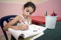 14-06-2008 - Schoolgirl in a temporary classroom, at Nahr al-Bared Palestinian refugee camp. © Ron Coelle