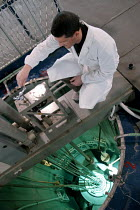 22-03-2005 - Technician inserting samples of irradiated material into the reactor. Nuclear Reactor for research Triga Mark II. Lena -Laboratory for Energy NUCLEAR applied. University of Pavia, Italy © Dino FRACCHIA