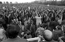 02-11-1981 - BL Mass meeting Cofton Park, Longbridge. November 1981 Over the tops of heads of Jack Adams (bald rhs bottom and Brian Chambers lhs bottom). © Roy Peters