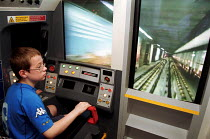 24-05-2001 - When I grow up I want to be a train driver - young boy tries out London Underground train simulator at a transport exhibition held at Olympia © Stefano Cagnoni