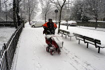 08-01-2003 - Postman delivering post on his early morning round during heavy snow © Stefano Cagnoni