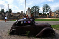 24-08-2004 - Tourists examine the remnants of a car in Oradour-sur-Glane, a town in France left in ruins to commemorate the Nazi massacre that took place there during the Second World War © Stefano Cagnoni