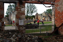 24-08-2004 - Tourists filter quietly through Oradour-sur-Glane, a town in France left in ruins to commemorate the Nazi massacre that took place there during the Second World War © Stefano Cagnoni