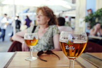 06-08-2011 - Two glasses of Leffe Beer on a table at a cafe in Arles in southern France. The beer is brewed by InBev Belgium © Stefano Cagnoni