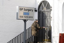 24-02-2012 - Elderly man entering his GP's Surgery in Archway, north London for an appointment with his doctor. © Stefano Cagnoni
