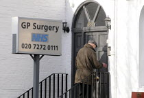 24-02-2012 - Elderly man entering his GP's Surgery in Archway, north London, for an appointment with his doctor. © Stefano Cagnoni